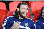 West Ham's sub Andy Carroll is all smiles as he sits on the bench.  Barclays Premier league, Cardiff city v West Ham Utd match at the Cardiff city Stadium in Cardiff, South Wales on Saturday 11th Jan 2014.<br /> pic by Andrew Orchard, Andrew Orchard sports photography.