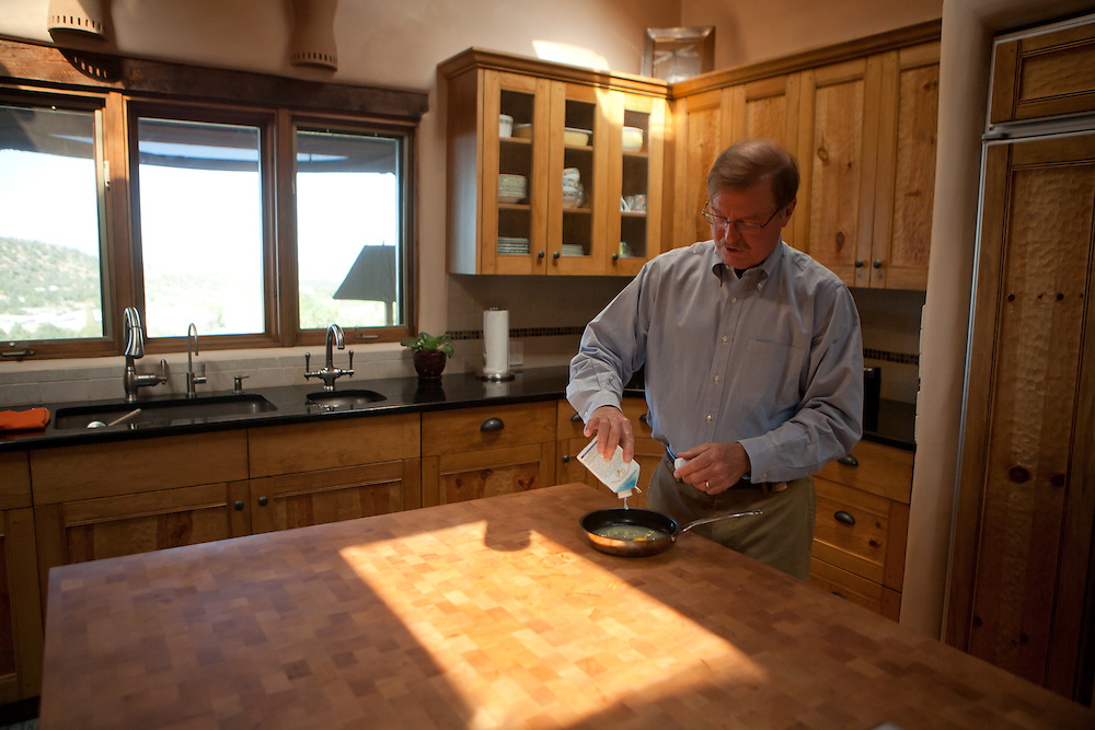 Former Merrill Lynch executive James A. Brown makes a late breakfast for himself at his Santa Fe New Mexico home on October 15, 2010...Credit: Steven St. John for The Wall Street Journal.ENRON