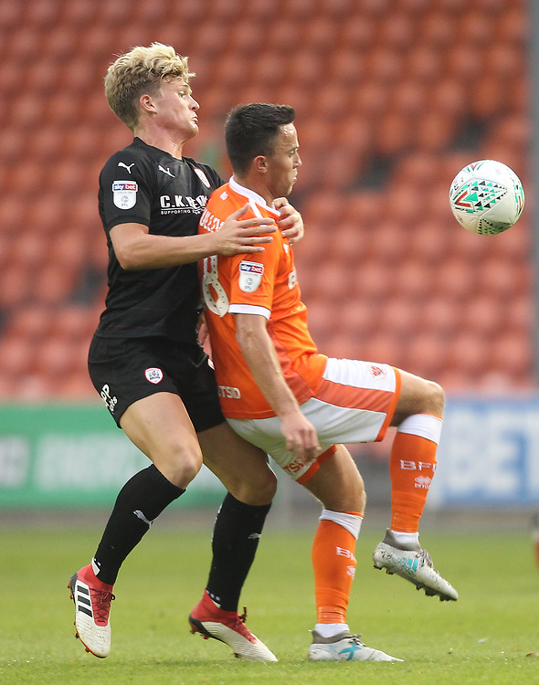 Blackpool's John O'Sullivan  battles with Barnsley's Cameron McGeehan<br /> <br /> Photographer Mick Walker/CameraSport<br /> <br /> Carabao Cup First Round - Blackpool v Barnsley - Tuesday August 14th 2018 - Bloomfield Road - Blackpool<br />  <br /> World Copyright © 2018 CameraSport. All rights reserved. 43 Linden Ave. Countesthorpe. Leicester. England. LE8 5PG - Tel: +44 (0) 116 277 4147 - admin@camerasport.com - www.camerasport.com