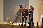 Grace Jones, Philip Treacy and Naomi Campbell. Moet and Chandon fashion tribute to Philip treacy. V. & a. 16 April 2002. © Copyright Photograph by Dafydd Jones 66 Stockwell Park Rd. London SW9 0DA Tel 020 7733 0108 www.dafjones.com