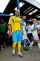 Photo: Richard Lane.<br />Bristol Rovers v Wycombe Wanderers. Coca Cola League 2. 08/08/2006. <br />Wycombe's captain, Tommy Moody leads his team out in Bristol Rovers kit.