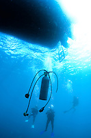 Scuba tank hanging underwater for divers making a safety stop after a deep dive, St. Lucia.
