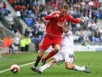 Photo: Paul Thomas.<br /> Bolton Wanderers v Liverpool. The Barclays Premiership. 30/09/2006.<br /> <br /> Peter Crouch (L) of Liverpool gets tackled by Tal Ben Haim.