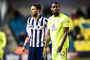 Peterborough United midfielder Anthony Grant (42), Millwall forward Lee Gregory (9) during the EFL Sky Bet League 1 match between Millwall and Peterborough United at The Den, London, England on 28 February 2017. Photo by Sebastian Frej.