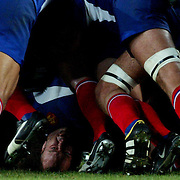 The head of French captain Yannick Bru peers out of the scrum during the third-place play-off match against New Zealand during the Rugby World Cup. New Zealand won the match 40-13. Sydney, Australia.