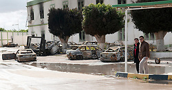 © under license to London News Pictures. 24/02/2011. Two men walk through the burnt out Army compound in the Libyan city of Benghazi. After firece fighting, forces loyal to Gadaffi were defeated and the Opposition took control. Photo credit should read Michael Graae/London News Pictures