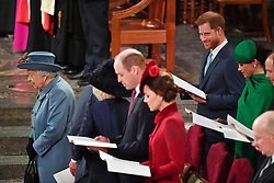 The Duke of Sussex (right) smiles towards the Prince of Wales and the Duchess of Cornwall (hidden) during the Commonwealth Service at Westminster Abbey, London on Commonwealth Day. The service is the Duke and Duchess of Sussex's final official engagement before they quit royal life.
