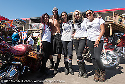 The Iron Lilies with bartender Sloan Gasior at the Iron Horse Saloon after the Harley-Davidson Angels Ride during the annual Sturgis Black Hills Motorcycle Rally.  SD, USA.  August 12, 2016.  Photography ©2016 Michael Lichter.