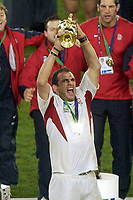 Photo. Steve Holland. England v Australia Final at the Telstra Stadium, Sydney. RWC 2003.<br />22/11/2003.<br />Martin Johnston with the Web Ellis Cup after winning the World Cup