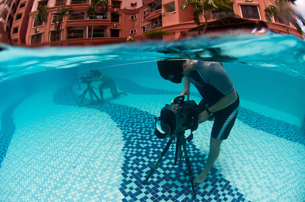 The cameramen are using Amphibico housings equipped with wide-angle domes mounted on tripods