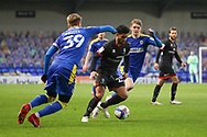 AFC Wimbledon striker Joe Pigott (39) and AFC Wimbledon midfielder Jack Rudoni (12) battles for possession with Lincoln City midfielder Liam Bridcutt (23) during the EFL Sky Bet League 1 match between AFC Wimbledon and Lincoln City at Plough Lane, London, United Kingdom on 2 January 2021.
