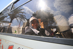August 14, 2017 - Gaza City, The Gaza Strip, Palestine - A Palestinian Muslim pilgrim waves to his relatives from a bus before leaving for the annual hajj pilgrimage to the holy city of Mecca, in Gaza City, Monday Aug. 14, 2017. (Credit Image: © Hatem Omar/Quds Net News via ZUMA Wire)