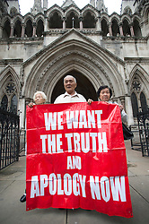© London News Pictures. 08/05/2012. London, UK. L to R Chong Koon Ying, Loh Ah Choi  and Lim Ah Yin , Family of Malaysians killed by British soldiers leaving The High Court in London on May 08, 2012. The Family members of 24 villagers killed by UK troops  when Malaya was part of the British Empire are seeking an inquiry into their deaths which they claim were 'cold-blooded mass murder'. The judicial review is to be held on 8th and 9th of May. Photo credit: Ben Cawthra/LNP