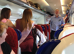 © Licensed to London News Pictures. 02/10/2015.  Labour leader JEREMY CORBYN talking to a group of women on a hen night out while on a train journey during his visit to Scotland yesterday (Thurs).  Photo credit: Henry Bell/LNP