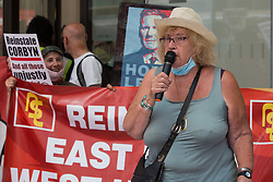London, UK. 20th July, 2021. Harriet Bradley of Bristol addresses supporters of left-wing Labour Party groups at a protest lobby outside the party's headquarters. The lobby was organised to coincide with a Labour Party National Executive Committee meeting during which it was asked to proscribe four organisations, Resist, Labour Against the Witchhunt, Labour In Exile and Socialist Appeal, members of which could then be automatically expelled from the Labour Party.