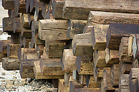 Old railroad ties stacked for later use.