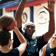 NBA basketball player Kobe BRYANT (C) and Turkish Basketball Club Anadolu Efes young team players durig their training at Anadolu Efes Sports Club at Istanbul, Turkey on 26 September 2011. Photo by TURKPIX