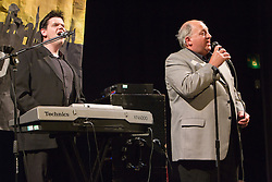 Visually impaired composer and singer and able bodied duo at concert