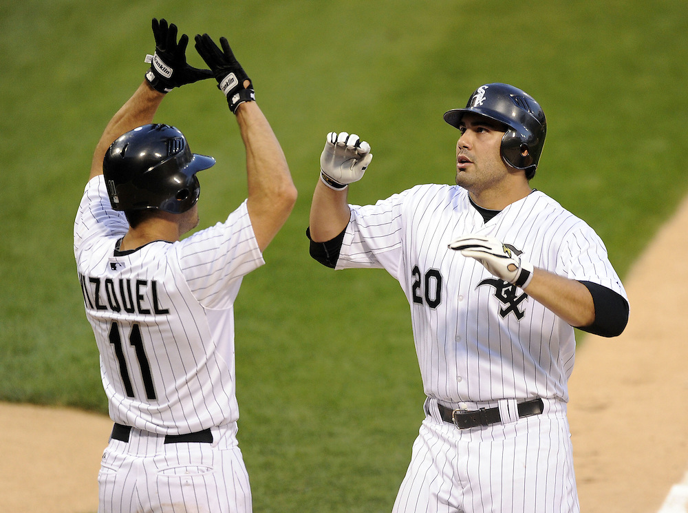 CHICAGO - JUNE 07:  Omar Vizquel #11 greets Carlos Quentin #20 of the Chicago White Sox after Quentin hit a two-run home run against the Seattle Mariners in the third inning on June 7, 2011 at U.S. Cellular Field in Chicago, Illinois.  The White Sox defeated the Mariners 5-1.  (Photo by Ron Vesely)  Subject:  Omar Vizquel;Carlos Quentin