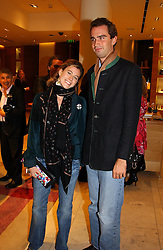 FRANCESCA VERSACE and FRITZ VON WESTENHOLTZ at a party hosted by Burberry to launch their special collection in aid of Breakthrough Breast Cancer, held at 21-23 New Bond Street, London W1 on 5th October 2004.<br />