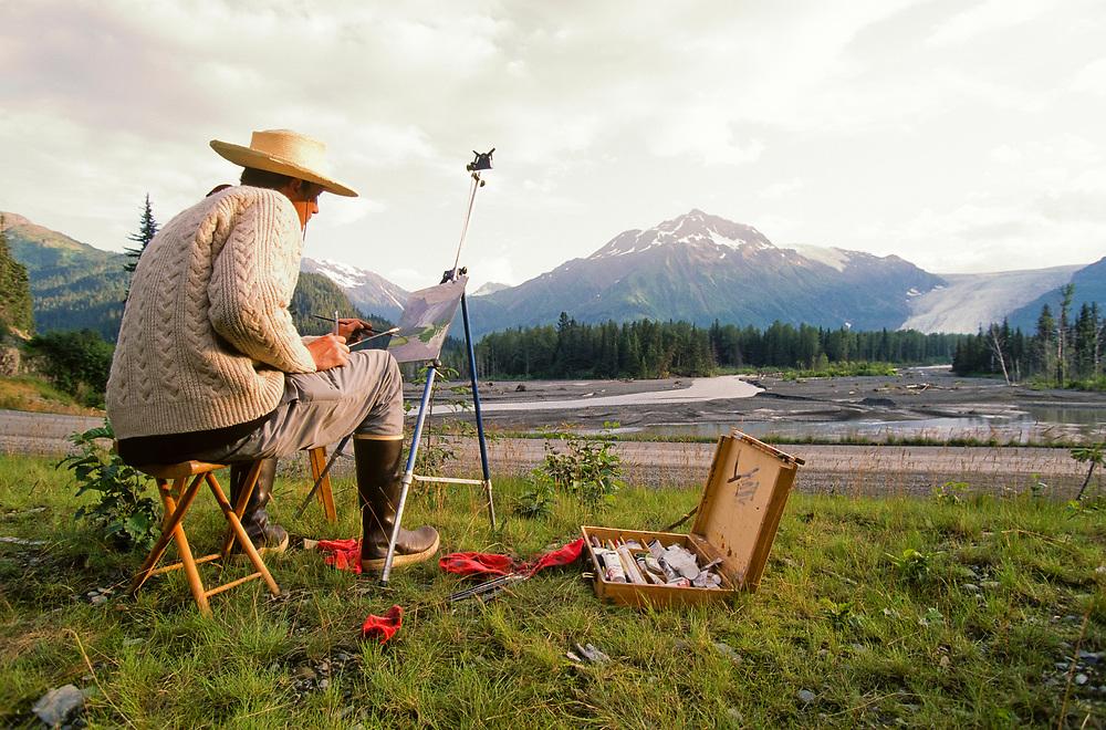 Alaska. Kenai Fjords National Park. Artist paints landscape scene at Exit Glacier.MR