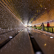 This LED sculpture by artist Leo Villareal is part of moving walkway between the East and West buildings of the National Gallery of Art in Washignton, DC. Programmed to form dynamic configurations of white light conveying associations ranging from artificial life to organic form, the programming both instructs the lights and allows for an element of chance. While it's possible that a pattern will repeat during a viewer's experience, it is unlikely. It is one amazingly cool exhibit!