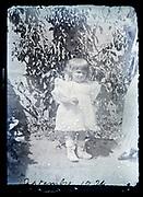 little child standing in garden France 1924