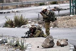 """23.10.2015, Nablus, PSE, Gewalt zwischen Palästinensern und Israelis, im Bild Zusammenstösse zwischen Palästinensischen Demonstranten und Israelischen Sicherheitskräfte // Israeli security forces aim their guns at Palestinian protesters during clashes at the Hawara checkpoint, south of the West Bank city of Nablus on October 22, 2015. Palestinian factions called for mass rallies against Israel in the occupied West Bank and East Jerusalem in a """"day of rage"""" on Friday, as world and regional powers pressed on with talks to try to end more than three weeks of bloodshed, Palestine on 2015/10/23. EXPA Pictures © 2015, PhotoCredit: EXPA/ APAimages/ Nedal Eshtayah<br /> <br /> *****ATTENTION - for AUT, GER, SUI, ITA, POL, CRO, SRB only*****"""