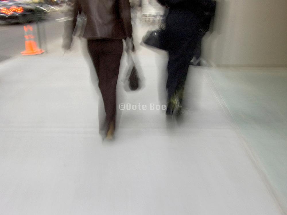 two fashionable woman walking streets New York