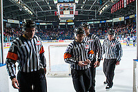 KELOWNA, CANADA - DECEMBER 30: Ice officials, referees Reid Anderson and Troy Paterson and Linesmen Dustin Minty and Kevin Crowell exit the ice at the against the Kelowna Rockets on December 30, 2016 at Prospera Place in Kelowna, British Columbia, Canada.  (Photo by Marissa Baecker/Shoot the Breeze)  *** Local Caption ***