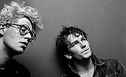 Photo of Bono and Adam Clayton back stage after U2 concert  at the Hammersmith Palais London 1981