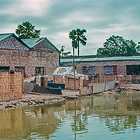 in 1977 hundreds of families lived at Mirpur Destitute Camp, a bombed-out soap factory near Dhaka, Bangladesh, left homeless , destitute and often widowed  by  back-to -back cyclone and  brutal 1971 war of independence.