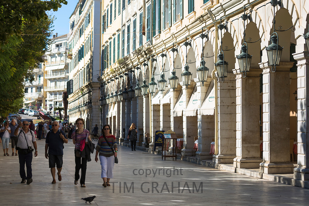 People strolling along the arcades of the Liston at the Spianada in Kerkyra, Corfu Town, Greece