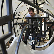 Pete works the rope settings inside the giant head. The head will be mobile and controled by a puppeteer inside the body of the bear. Aurora is a giant polar bear puppet, the size of a London double decker bus. The bear is the brain child of Greenpeace UK and it will be the center piece in the Greenpeace campaign Save the Arctic  global day of action in London Sept 15th. Aurora is designed by Christopher Kelly in collaboration with props designer Simon Costin and made by Factory Settings in East London.