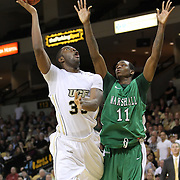 Central Florida forward Keith Clanton (33) shoots past Marshall center Nigel Spikes (11) during a Conference USA NCAA basketball game between the Marshall Thundering Herd and the Central Florida Knights at the UCF Arena on January 5, 2011 in Orlando, Florida. Central Florida won the game 65-58 and extended their record to 14-0.  (AP Photo/Alex Menendez)