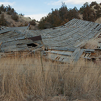 An abandoned building collapses into a field in the Gallatin Valley north of Bozeman, Montana.