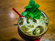 """27 JANUARY 2016 - BANGKOK, THAILAND: The """"Songkran"""" a signature cocktail at Tep Bar, a new bar and restaurant in the Chinatown neighborhood of Bangkok, is made with Thai white spirits, fermented mixed herbs and honey.       PHOTO BY JACK KURTZ"""