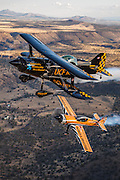 """Super Dave"" Mathieson in his MX2 and Jon Melby in his Pitts S-1-11B Muscle Bi-Plane."