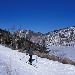Acadia National Park, ME.Cross country skiing on the Carriage Roads next to Jordan Pond and the Bubbles.