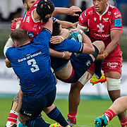 DUBLIN, IRELAND: October 16:  James Ryan #5 of Leinster is tackled by Sam Lousi #4 of Scarlets and Blade Thomson #8 of Scarlets as Tadhg Furlong #3 of Leinster assists during the Leinster V Scarlets, United Rugby Championship match at RDS Arena on October 16th, 2021 in Dublin, Ireland. (Photo by Tim Clayton/Corbis via Getty Images)