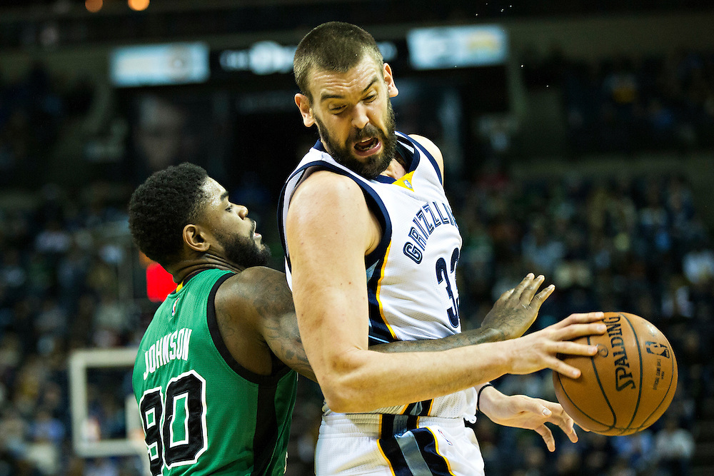 """MEMPHIS, TN - JANUARY 10:  Marc Gasol #33 of the Memphis Grizzlies tries to get to the basket while being defended by Amir Johnson #90 of the Boston Celtics at FedExForum on January 10, 2016 in Memphis, Tennessee.  """"NOTE TO USER: User expressly acknowledges and agrees that, by downloading and or using this photograph, User is consenting to the terms and conditions of the Getty Images License Agreement.""""  (Photo by Wesley Hitt/Getty Images) *** Local Caption *** Marc Gasol; Amir Johnson"""