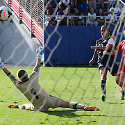 U.S. midfielder Carli Lloyd (10) scores a goal against Russia goalkeeper Elvira Todua (1) during an international friendly soccer match between the United States Women's National soccer team and the Russia National soccer team at FAU Stadium on Saturday, February 8, in Boca Raton, Florida. (AP Photo/Alex Menendez)