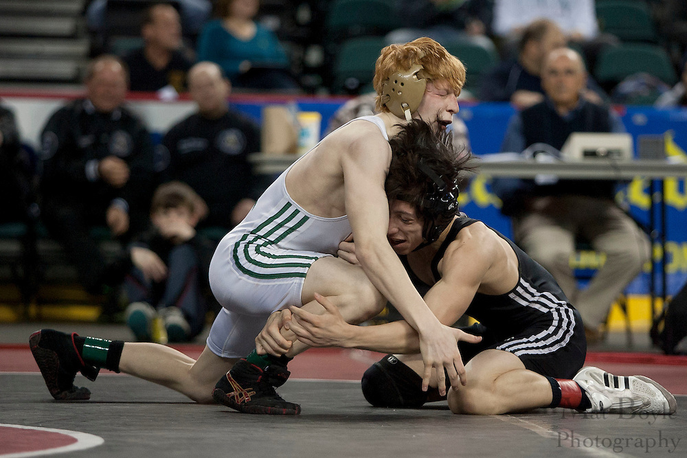 Ryan Pomrinca of North Hunterdon High School defeats by decision 4-3 Marc Mastropietro of Hasbrouck Heights High School during the NJSIAA State Wrestling consolation  7th place match in the 113 lb weight class  at Boardwalk Hall in Atlantic CIty on Sunday March 4, 2012. (photo / Mat Boyle)