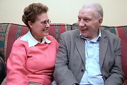 Older couple sitting on the sofa,