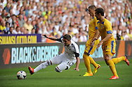 Pablo Hernandez of Swansea city goes down as he fends off the challenge of Gheorghe Grozav of Petrolul Ploiesti <br /> UEFA Europa league, play off round, 1st leg match, Swansea city v FC Petrolul Ploiesti at the Liberty stadium in Swansea on Thursday 22nd August 2013. pic by Phil Rees , Andrew Orchard sports photography,