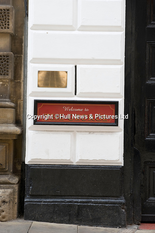27 August 2014 Images of Kingston Upon Hull, East Yorkshire. <br /> The Land of Green Ginger in Hull's old town showing the George Pub, one of England's oldest. Pictured is England's smallest window, a narrow slit in the wall.<br /> Picture: Sean Spencer/Hull News & Pictures Ltd<br /> 01482 772651/07976 433960<br /> www.hullnews.co.uk   sean@hullnews.co.uk
