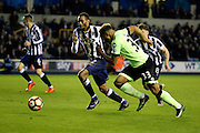 Millwall defender Shaun Cummins (2) and Bournemouth Midfielder Jordon Ibe (33) battles for possesion during the The FA Cup 3rd round match between Millwall and Bournemouth at The Den, London, England on 7 January 2017. Photo by Matthew Redman.