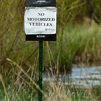 A sign warns the public to keep motorized vehicles out of a fragile riparian area in the Blackfoot valley's Clearwater Game Range in Montana.