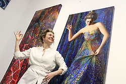 May 12, 2019 - New York City, New York, U.S. - Artist IRIS SCOTT, the world's first-ever full time professional finger-painter poses in front of her 11 foot self-portrait  'I of the Needle'  during her art opening held at the Filo Sofi Arts Gallery in Chelsea. (Credit Image: © Nancy Kaszerman/ZUMA Wire)