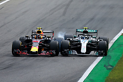September 2, 2018 - Monza, Italy - #33 MAX VERSTAPPEN, left, of Aston Martin Red Bull Racing, collides with #77 VALTTERI BOTTAS of Mercedes AMG Petronas Motorsport in Turn 1 during the Formula One Grand Prix of Italy, at Monza. Verstappen received a 5 second penalty for 'causing a collision.' (Credit Image: © Hoch Zwei via ZUMA Wire)